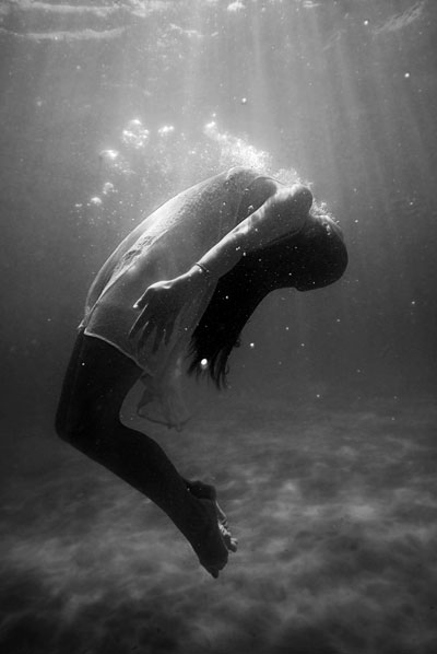 Woman drifting underwater